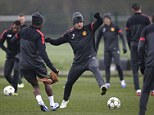 Eye on the ball: Wayne Rooney (centre) trains with his Manchester United team-mates on Tuesday