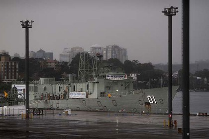 Delays ...   the HMAS Adelaide berthed at White Bay.