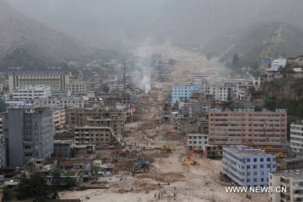 Photo taken on Aug. 13, 2010 shows the landslide-hit Zhouqu County, Gannan Tibetan Autonomous Prefecture in northwest China's Gansu Province. The death toll from the massive mudslide in zhouqu has risen to 1,156 as of 4 p.m. Friday, with 588 still missing, local authorities said.  (Xinhua/Wang Peng) (wy)