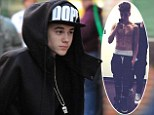 What his Secret? Justin Bieber hides his muscles in huge hoodie as he arrives for lingerie show rehearsal... days after revealing beefed-up new look
