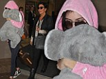 A new furry friend! Kendall Jenner takes a piece of Australia home with her as she carries a giant souvenir Koala toy bear