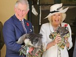 Prince Charles holds a koala called Kao whilst Camilla holds a koala called Matilda at Government House in Adelaide