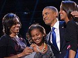 Delighted: Sasha, second left, and Malia, right, looked clearly thrilled when they appeared on stage last night with their mother and First Lady Michelle and their victorious father