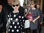 Dotted around town: Taylor Swift gets spotted in a black and white polka dot jumper