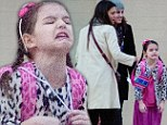 Movie star in the making! Suri Cruise has her mother Katie Holmes chuckling with some very funny faces