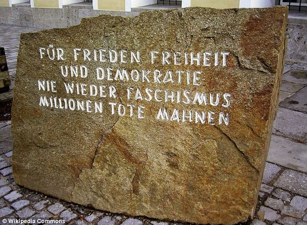 Marker: A memorial stone (pictured) was placed outside the building in 1989 as a reminder of its history. In English the inscription reads 'For Peace, Freedom and Democracy. Never Again Fascism. Millions of Dead Remind [us]'