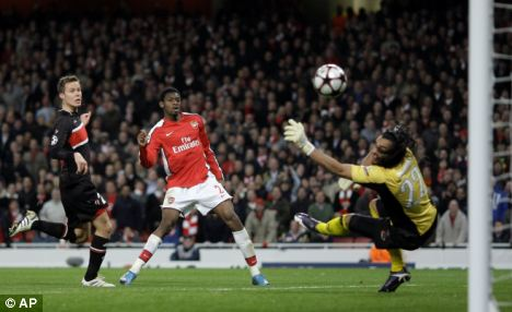 Abou Diaby (centre) in action for Arsenal