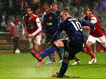 Spot on: Wayne Rooney slots home a penalty during United's Champions League win over Braga