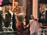 Ever the doting mother: Gwen Stefani treats her youngest son Zuma to a German pretzel on a trip to Frankfurt