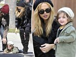 Baby steps! Little Skyler takes a tumble after being swung by parents Rachel Zoe and Rodger Berman