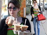Recharge: Emma Roberts stepped out for a caffeine pick-me-up on Friday that included three iced coffees