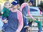 Just the two of us! Owen Wilson and his one-year-old mini-me son Robert take their beloved pooch to the dog park
