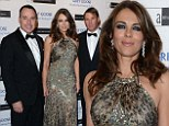 Wild things: Liz Hurley was flanked by Shane Warne and David Furnish