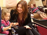 Pampering time! Alyson Hannigan and little Satyana have mani pedi outing after mother daughter lunch by the sea