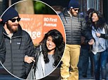 Who's that girl? A bearded Jake Gyllenhaal looks smitten as he steps out with mystery brunette on his arm