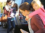 Talk about a handful! Jennifer Garner carries daughter Seraphina, heavy bag and water bottle