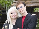 Forever faithful: Edwina Gibb, pictured with Robin in 2008, says she still listens to his music to feel close to him