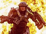 Tom Cruise is ready for battle as he sprints through fiery explosion in first film still from All You Need Is Kill