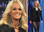 Ditching the country look! Carrie Underwood embraces her inner rock chick with sexy tights as she makes appearance on Jimmy Fallon's show