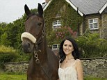 End of a dream: Liz stands outside her farmhouse with a horse she rescued. After five years, she is relieved to be moving back to London