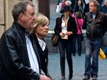 Flowers for the lady: Jeremy Clarkson pictured strolling through Rome with ex-mistress Phillipa Sage