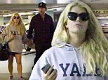 Defiant Jessica Simpson slips on tiny shorts as she steps out with Eric Johnson following reports 'she slipped up on Weight Watchers diet'