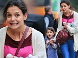Like mother like daughter! Katie Holmes and Suri pull matching grimaces as they head out for ice-cream treat
