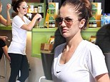 Full throttle! Minka Kelly refuels with a smoothie after a gruelling workout session