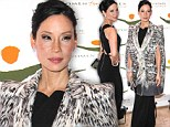 Champion for peace: A serene-looking Lucy Liu is honoured for her charity work