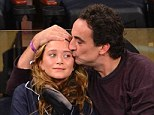 Determined to prove them all wrong: Mary-Kate Olsen and Olivier Sarkozy cuddle up