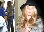 Getting ready for her runway! Rosie Huntington-Whiteley manages to look every inch the supermodel... even through airport security