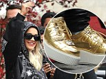 Paved with gold: Rita Ora steps out in fancy footwear as she heads to the MTV European Music Awards