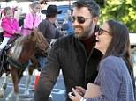 Enjoying the pony show! Ben Affleck and Jennifer Garner laugh as daughters enjoy a ride
