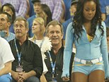Keeping his eyes OFF the ball: Mel Gibson can't help himself as he ogles cheerleaders at the basketball