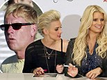 United front: Jessica and Ashlee Simpson keep close at autograph signing in first joint appearance since 'gay' father rumours