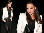 Out of the shadows: Pippa Middleton steps out in a monochrome outfit as she dines with a friend
