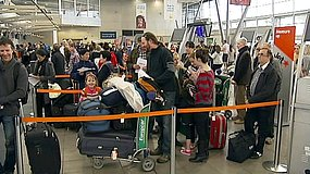 Jetstar passengers queue after ash from a volcanic eruption in Chile postponed flights