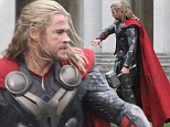 Waiting for the hammer to fall? Chris Hemsworth shoots scenes for Thor 2 and keeps his superhero prop close to him