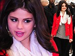 Brave and smiling: Selena Gomez put on a happy face for her promotional gig at K-Mart in White Plains, New York, another sign 'it's not over' with Justin Bieber
