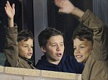We're over here dad! Romeo Beckham waves to David as he joins brothers Brooklyn and Cruz to watch LA Galaxy match