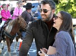 Enjoying the pony show! Ben Affleck and Jennifer Garner laugh as daughters enjoy a ride