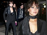 Suits you miss! Femme fatale Jennifer Lawrence shows off her bra under a chic black tuxedo as she attends premiere of her new film