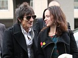 Smitten: Ronnie Wood and his fiancée Sally Humphreys looked utterly loved-up as they enjoyed a romantic stroll in Paris together