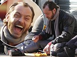 Jude Law was happy to dine on the floor of a London street on the set of his new movie on Sunday