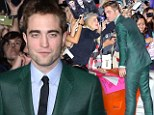 Let's give them something to talk about: R-Patz diverts attention from his on-again-off-again relationship with the help of an eye-popping emerald green suit