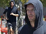 Viva la vida! Chris Martin keeps up with his healthy lifestyle on tour as he goes for a run in between gigs