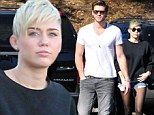 Miley Cyrus and fiancé Liam Hemsworth put on a united front following flirting rumours as she tweets she is 'in need of girlfriends'