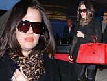 My, what a big bag you have! Khloe Kardashian totes oversized $20,000 red designer Birkin at LAX
