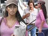 Pregnant Camila Alves puts her growing bump on display in pink as she pays a visit to shrinking husband Matthew McConaughey on set