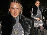 Going thigh-high! Alessandra Ambrosio makes the best of her model legs as she steps out in sexy boots